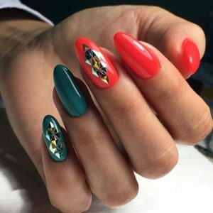 green and red nails with holographic patterns