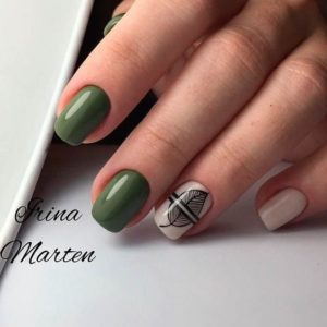 green nails with a leaf