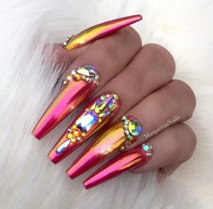 Pink and orange chrome nails with embellishment