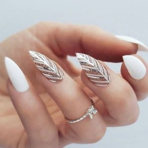 White stiletto nails with gold foils