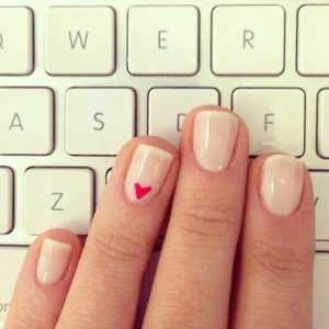 nude nail with heart