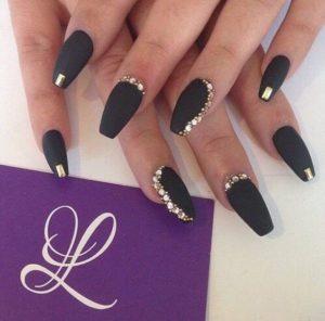 gold stones on black