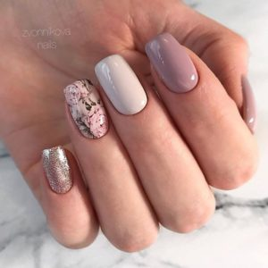 pink roses on ring finger nail