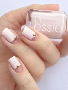 three quarters nail painted with gold beads