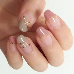 natural green and pink nail tips with shell edges