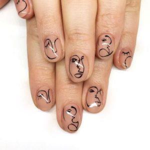 Abstract nail art of faces