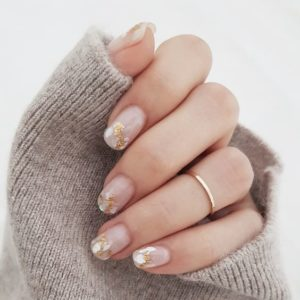 Shell pieces stuck over nail tips