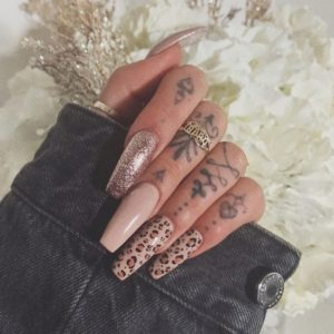 nude based leopard print on accent nails
