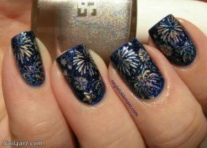 fireworks nail art on dark blue polish