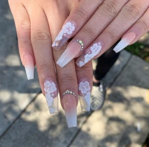 floral nail art on clear acrylic nails