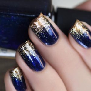 dark blue and gold glitter ombre nails