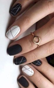 linear detail on black and white nails
