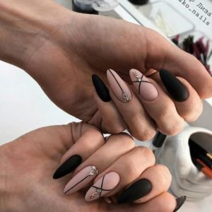lines and gem details on nude and black nails