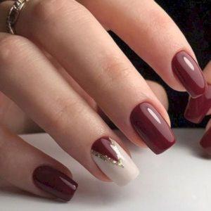 maroon nails with triangle nail art