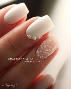 white delicate nail art