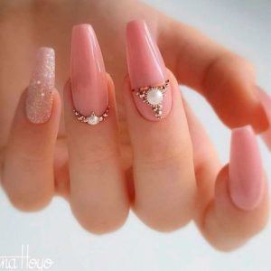 pearl detailing on nude pink nails