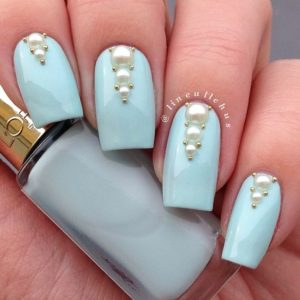 Baby blue nails with pearl decoration