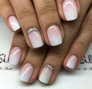 nude ombre nails with gems on accent nail