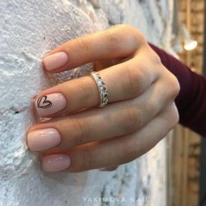scribbled heart nail art on nude nails