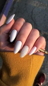 White nails with accented sparkly nail