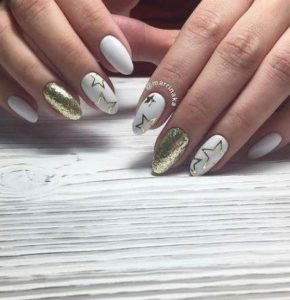 Gold star stickers on white base polish