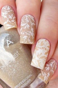 White leaves on gold glitter base and gold leaves on white glitter base