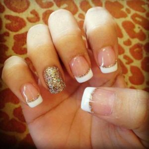 White french manicure with a gold glitter edge