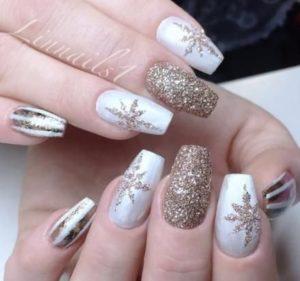 gold snow flakes on pearl white base polish