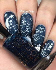 Navy blue nail polish base with stars and space nail art
