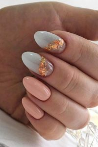 nail partitioned with gold foil lining