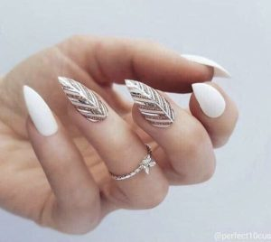 Gold feather effect on accent nails on white base polish