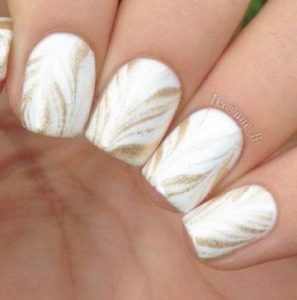 Soft gold strokes from centre of nail