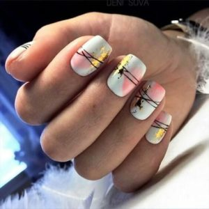 Blotches of nail foil and nail paint with lines crossing over