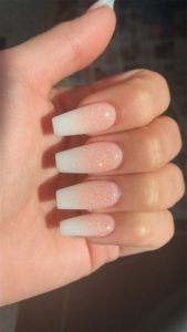 small gold glitter on french manicure nails