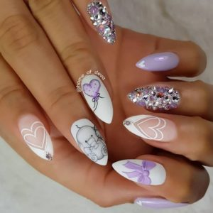 heart designs and nail art with rhinestones