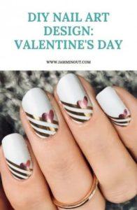 Gold metallic stripes and heart on white base polish