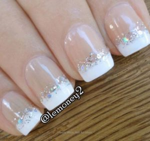 Silver glitter and the bottom of white nail tips