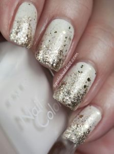 Gold glitter gradient from nail tips on white polish