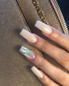 Reflective foil on accent nail