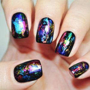 Different metallic colour nail foil on black nails