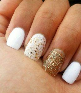 gold confetti polish on accent nail