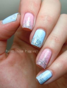 pink and blue nails with glitter polish on tips