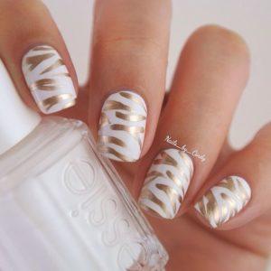 metallic gold brush strokes on white nail polish