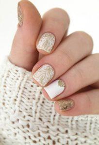 Roman gold nail art on white nail polish
