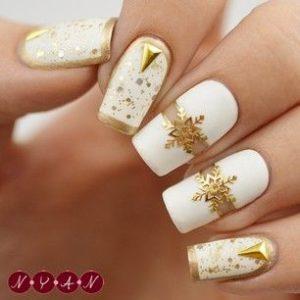 gold snowflakes on white base polish