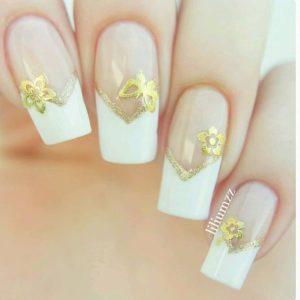 French manicure with gold edge and gold flower