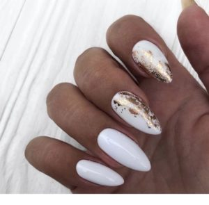Gold foil over white base polish on accent nails