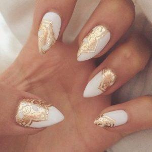 Gold lace pattern stickers on white base polish