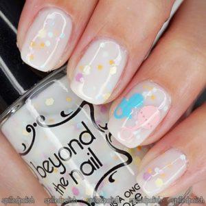 confetti glitter polish over white nail polish