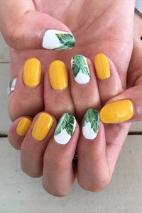 yellow nails with palm leaves nail art